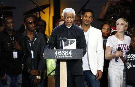 Former South African President Nelson Mandela speaks during the 46664 concert in his honor in Hyde Park, London June 27, 2008. REUTERS/Andrew Winning