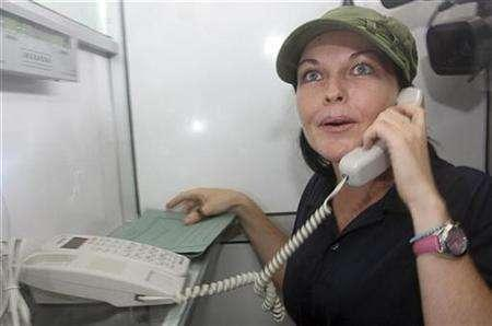 Prisoner Schapelle Leigh Corby from Queensland, Australia, who is currently serving a 20-year sentence in Bali for drug smuggling, makes a phone call in Kerobokan prison in the resort island of Bali February 4, 2008. REUTERS/Stringer
