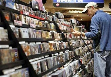 A man looks at music CDs inside the Virgin Megastore in New York November 26, 2007.REUTERS/Shannon Stapleton
