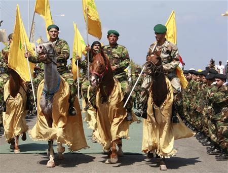 Hezbollah fighters ride horses as they take part in a military parade during the handing over of the bodies of two Israeli soldiers to the Red Cross to be exchanged for Lebanese prisoners held by Israel at the Naqoura border point with Israel, July 16, 2008.REUTERS/Jamal Saidi