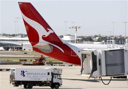 A Qantas plane prepares for take-off at Sydney's International Airport July 18, 2008. REUTERS/Mick Tsikas