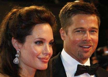 Angelina Jolie (L) and actor Brad Pitt leave after the screening of ''The Exchange'' by U.S. director Clint Eastwood at the 61st Cannes Film Festival May 20, 2008. REUTERS/Vincent Kessler