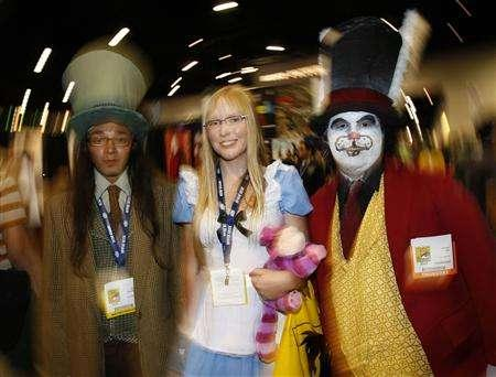 Attendees dress up as characters from ''Alice in Wonderland'' at the 39th annual Comic Con Convention in San Diego July 24, 2008. REUTERS/Mike Blake