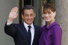 <p>Nicolas Sarkozy e sua mulher, Carla Bruni, que distribuiu seu disco para os ministros . Photo by Benoit Tessier</p>