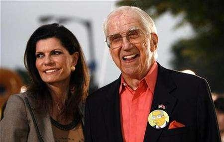 Celebrity guest voice on the television series ''The Simpsons'' Ed McMahon and his wife Pamela attend the premiere of ''The Simpsons Movie'' at the Mann Village theatre in Westwood, California July 24, 2007. McMahon's financial and legal woes worsened on Wednesday -- as well as fighting to save his home from foreclosure, he is now being sued for not paying a lawyer hired for his daughter. REUTERS/Mario Anzuoni