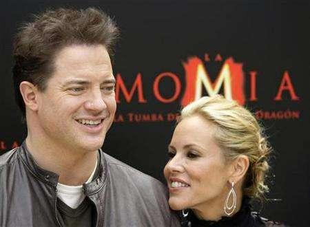 Actors Brendan Fraser (L) and Maria Bello pose during a photocall to promote the movie ''The Mummy: Tomb of the Dragon Emperor'' in Madrid July 21, 2008. REUTERS/Susana Vera