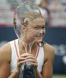 <p>Россиянка Динара Сафина радуется победе над Доминикой Цибулковой в Монреале 3 августа 2008 года. Россиянка Динара Сафина одержала победу в теннисном турнире Montreal Cup. (REUTERS/Christinne Muschi)</p>
