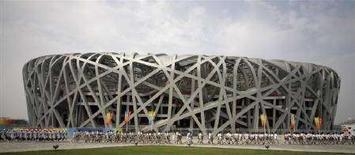 <p>Una prova della cerimonia di apertura. REUTERS/Jason Lee (CHINA)</p>