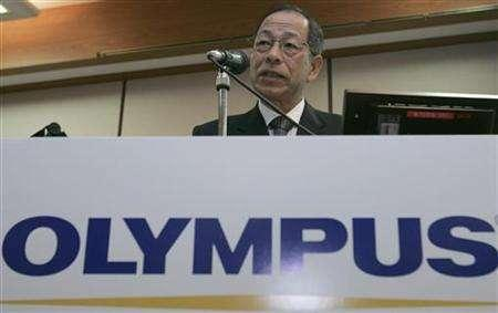 Japanese medical equipment and digital camera maker Olympus Corp President Tsuyoshi Kikukawa speaks during a news conference in Tokyo November 19, 2007. Olympus Corp and Matsushita announced a new digital camera format on Tuesday that will make single lens reflex (SLR) models smaller and lighter, in a bid to drive sales of their advanced machines. REUTERS/Yuriko Nakao