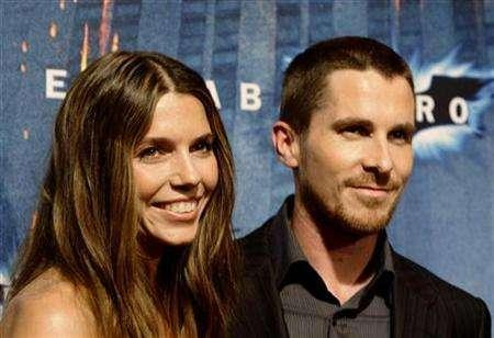 British actor Christian Bale and his wife Sandra ''Sibi'' Blazic pose during a photocall for the film ''The Dark Knight'' in central Barcelona July 23, 2008. REUTERS/Gustau Nacarino