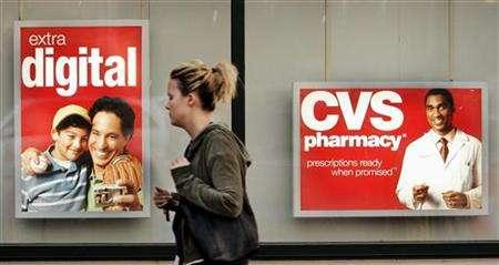 A pedestrian walks past a CVS drugstore in Boston, November 1, 2006. REUTERS/Brian Snyder