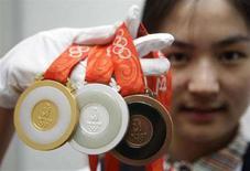 <p>Olimpiadi: 17 ori per la Cina, Italia al 5° posto. REUTERS/Jason Lee</p>