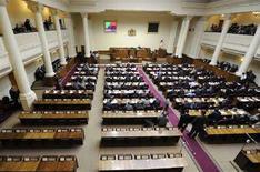 """<p>Заседание грузинского парламента, бойкотированное представителями оппозиции, в Тбилиси 7 июня 2008 года. Парламент Грузии в четверг единогласно проголосовал за выход из СНГ, а также принял обращение к международной общественности помочь избавиться от """"российских оккупантов"""". (REUTERS/Irakli Gedenidze/Pool)</p>"""