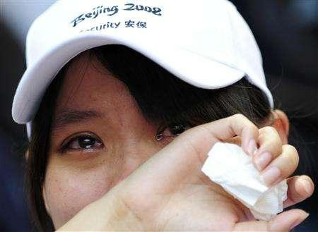 A supporter cries after China's Olympic champion Liu Xiang failed to start his 110 metres hurdles first-round heat of the athletics competition at the Beijing 2008 Olympic Games, August 18, 2008. REUTERS/Dylan Martinez