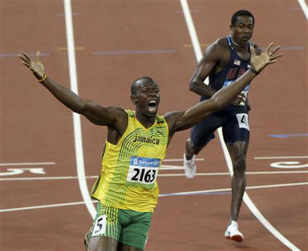 Usain Bolt of Jamaica celebrates winning the men's 200m final at the Beijing 2008 Olympics August 20, 2008. Bolt set a new world record with a timing of 19.30 seconds. REUTERS/David Gray