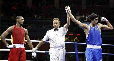 The referee declares Vijender Kumar (R) of India the winner in the men's middleweight quarterfinal 4 boxing match Carlos Gongora of Ecuador at the Beijing 2008 Olympic Games August 20, 2008. REUTERS/Lee Jae-Won