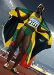 <p>La giamaicana Veronica Campbell-Brown festeggia la vittoria nei 200 metri. REUTERS/Jerry Lampen (CHINA)</p>