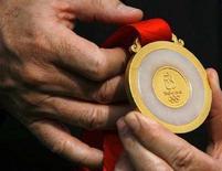 <p>Cina prima nel medagliere finale delle Olimpiadi, secondi gli Usa, Italia nona. REUTERS/David Gray</p>