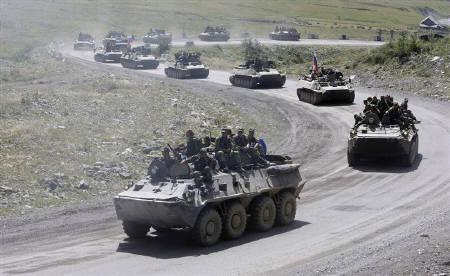 Russian military vehicles approach the Russian border as they drive through the northern part of breakaway South Ossetia August 24, 2008. REUTERS/Denis Sinyakov