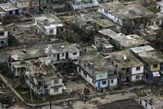 """<p>Вид на дома, пострадавшие от урагана """"Густав"""", на острове Юности 2 сентября 2008 года. Россия отправила на Кубу гуманитарную помощь пострадавшим от урагана """"Густав"""", подтвердив тем самым желание восстановить прочные отношения, которые были между двумя государствами в эпоху """"холодной"""" войны. REUTERS/Claudia Daut (CUBA)</p>"""