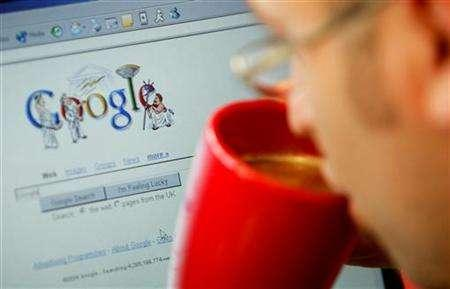 An Web surfer views the Google home page at a cafe in London, August 13, 2004. REUTERS/Stephen Hird