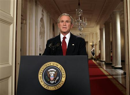 U.S. President George W. Bush poses for photographers after delivering an address to the nation on the financial crisis, at the White House in Washington September 24, 2008. REUTERS/Yuri Gripas