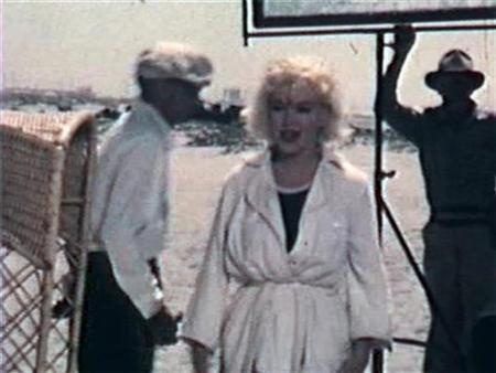A still from an amateur film of Marilyn Monroe on the film set of ''Some Like It Hot'' obtained September 4, 2008. An amateur film of Hollywood legend Marilyn Monroe on the set of ''Some Like It Hot'' has surfaced in Australia almost 50 years after it was shot and is being put up for auction. Auctioneer Charles Leski said the 2.5-minute-long, 8mm film shows Monroe and co-star Tony Curtis on the set ahead of shooting a beach scene in which the actress is bouncing balls to get the actor's attention. REUTERS/Charles Leski Auctions/Handout