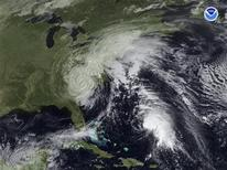 <p>Tropical Storm Kyle is seen in open water of the Atlantic Ocean southeast of South Carolina in this satellite image taken on September 26, 2008. REUTERS/National Oceanic and Atmospheric Administration/Handout</p>