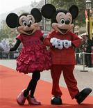 <p>People dressed as cartoon characters Mickey and Minnie greet visitors with their latest Year of the Mouse costumes at Hong Kong Disneyland January 21, 2008. REUTERS/Bobby Yip</p>