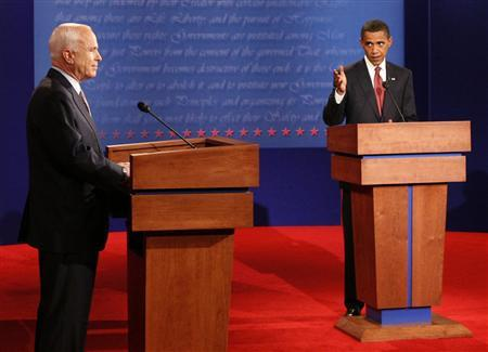 U.S. Democratic presidential candidate Barack Obama (R) makes a point as U.S. Republican presidential candidate John McCain listens during the first U.S. presidential debate at the University of Mississippi in Oxford, Mississippi, September 26, 2008. REUTERS/Jim Bourg/Pool