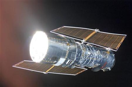 Hubble Space Telescope is seen in this picture taken from Space Shuttle in March 2002. REUTERS/NASA/Handout