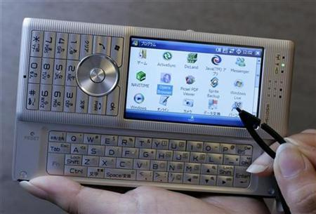 Willcom Inc's W-Zero3 handset is demonstrated for a photograph during an unveiling in Tokyo June 7, 2007. The phone is equipped with Microsoft's Windows Mobile 6 Classic. REUTERS/Yuriko Nakao