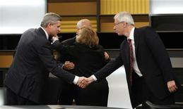 <p>Canadian Prime Minister Stephen Harper (L) shakes hands with Liberal Party Leader Stephane Dion as NDP Leader Jack Layton (2nd L) hugs Green Party Leader Elizabeth May following the English leaders' debate in Ottawa, October 2, 2008. REUTERS/Tom Hanson/Pool</p>