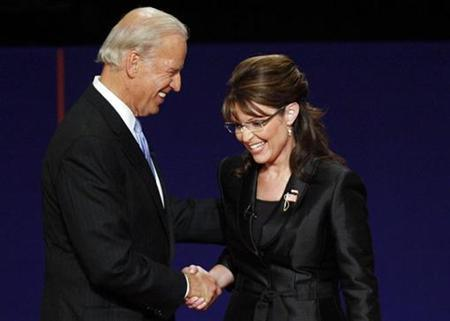 Republican vice presidential nominee Alaska Governor Sarah Palin and Democratic vice presidential nominee Senator Joe Biden (D-DE) shake hands and smile at the end of their vice presidential debate at Washington University in St. Louis, Missouri October 2, 2008. REUTERS/Larry Rubenstein