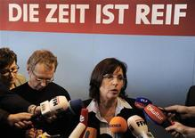 "<p>Hesse's Social Democratic Party (SPD) leader Andrea Ypsilanti answers reporter's questions while standing under a logo ""The time is right"" after an extraordinary party convention in Rotenburg an der Fulda, October 4, 2008. Social Democrats in the German state of Hesse on Saturday backed a plan to form a coalition with the Greens with support from a far-left party, paving the way for them to oust Chancellor Angela Merkel's conservatives in the state. REUTERS/Kai Pfaffenbach(GERMANY)</p>"