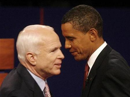 Republican presidential nominee Senator John McCain (R-AZ) (L) and Democratic presidential nominee Senator Barack Obama (D-IL) stand together onstage after the first presidential debate in Oxford, Mississippi, September 26, 2008. REUTERS/Jim Bourg