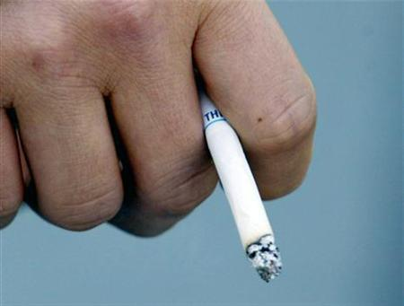A man holds a cigarette in a file photo. REUTERS/File