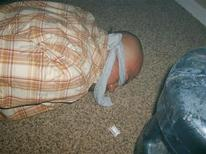 <p>A bound and blindfolded victim of kidnapping is shown moments before he was freed by police in Phoenix, Arizona in this undated handout picture released October 8, 2008. The criminal underworld in the sun-baked Arizona capital of Phoenix has long enjoyed the hot money profits from illicit smuggling of drugs and people over the border from Mexico. But now its members are living in fear as they are stalked by kidnappers after their proceeds, authorities say. REUTERS/Phoenix Police Department/Handout</p>