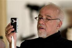 <p>Brazilian author Paulo Coelho takes a picture during an interview with Reuters at his home in Paris September 18, 2008. REUTERS/Charles Platiau</p>