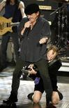<p>File photo shows singer Brian Johnson (top) and guitarist Angus Young of ACDC at New York's Waldorf Astoria Hotel, March 10, 2003. REUTERS/Mike Segar</p>