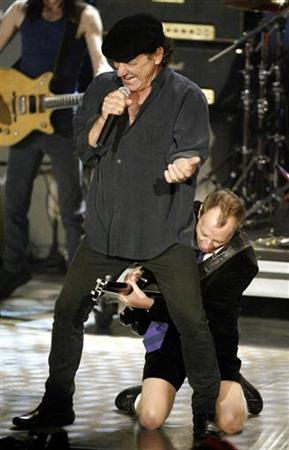 File photo shows singer Brian Johnson (top) and guitarist Angus Young of ACDC at New York's Waldorf Astoria Hotel, March 10, 2003. REUTERS/Mike Segar