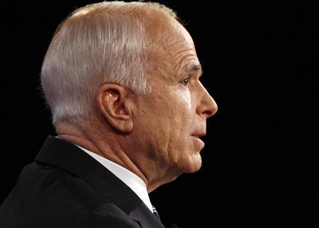 Republican presidential nominee Sen. John McCain (R-AZ) faces Democratic presidential nominee Sen. Barack Obama (D-IL) during their presidential debate at Hofstra University in Hempstead, New York October 15, 2008. REUTERS/Charles Dharapak/Pool