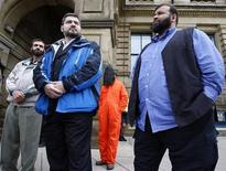 <p>Muayyed Nureddin (L), Abdullah Almalki (C) and Ahmad El Maati take part in a demonstration outside the Langevin Block, where Canada's Prime Minister Stephen Harper has an office, in Ottawa, May 8, 2008. REUTERS/Chris Wattie</p>