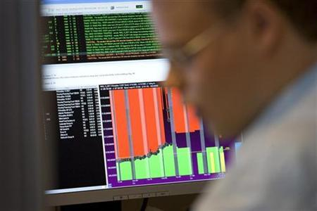 A share trader sits behind his terminal at the Icelandic stock exchange in Reikjavik, October 14, 2008. REUTERS/Thorvaldur Orn Kristmundsson