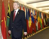 <p>Canada's Prime Minister Stephen Harper walks down the hall on his way to a meeting at the Francophonie Summit in Quebec City, October 19, 2008. The biennial summit of the 55-member countries with large French-speaking populations runs from October 17-19. REUTERS/Christinne Muschi</p>