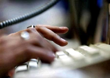 A person uses a computer keyboard in this undated file photo. REUTERS/Files