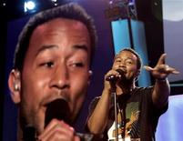 <p>Singer John Legend rehearses before the start of the 2008 Democratic National Convention in Denver, Colorado, August 25, 2008. REUTERS/Mike Segar</p>