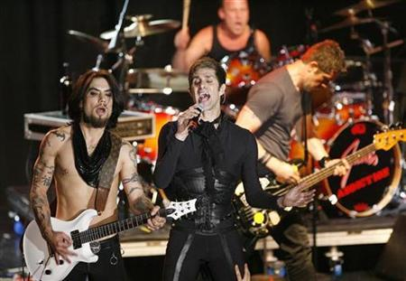 Lead singer Perry Farrell (C), guitarist Dave Navarro (L), bassist Eric Avery (R), and drummer Stephen Perkins of Jane's Addiction perform at the 2008 NME Awards USA at El Rey theatre in Los Angeles April 23, 2008. REUTERS/Mario Anzuoni