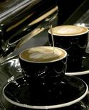 <p>Barista Carl Sara of New Zealand makes a latte art during the finals of the World Barista Championship in Tokyo August 2, 2007. It may seem unlikely, but simply clutching a warm cup of coffee can bring on a flood of warm feelings, U.S. researchers said on Thursday in a finding that suggests a strong link between physical and emotional warmth. REUTERS/Yuriko Nakao</p>