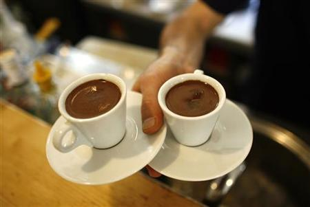 A waiter carries two cups of Turkish coffee at a coffee shop in Istanbul October 19, 2007. REUTERS/Osman Orsal
